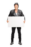 Young male motorcyclist holding a signboard Royalty Free Stock Images