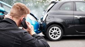 Free Young Male Motorist Involved In Car Accident Calling Insurance Company Or Recovery Service Stock Images - 157271984