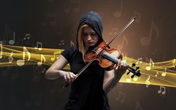 Musician playing on violin with notes around royalty free stock images