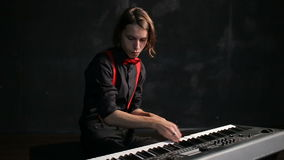 Young male musician playing piano stock footage