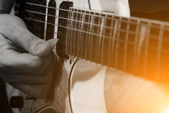 Young male musician with a white guitar Stock Photos