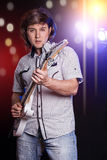 Young male musician with a white guitar Royalty Free Stock Image