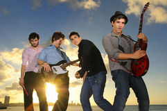 Young male musicians with instruments at sunset Royalty Free Stock Photography