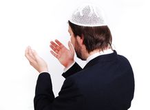 Young male muslim is praying and asking God Stock Photography