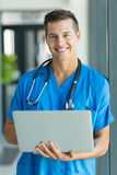 Young male nurse laptop Stock Photos