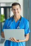 Young male nurse laptop Stock Photos