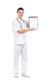 Young male nurse showing a clipboard with copy space Royalty Free Stock Image