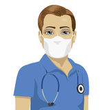 Young male nurse wearing surgical antiviral mask. Over white background Royalty Free Stock Photo