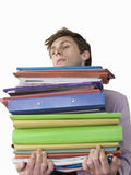 Young Male Office Worker Carrying Heavy Binders Stock Photos
