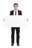Young male office worker standing with placard. Royalty Free Stock Images