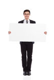 Young male office worker standing with placard. Royalty Free Stock Photo