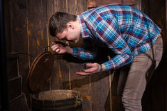 Young male opened a barrel and trying to solve a conundrum to ge. T out of the trap, escape the room game concept Stock Image
