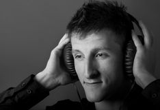 Young male person listening Royalty Free Stock Images