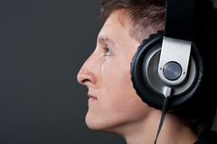 Young male person listening Stock Image