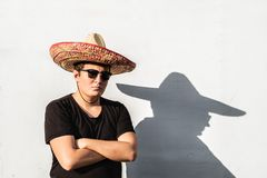 Young male person in sombrero. Mexico independence festive conce. Pt of man wearing national mexican hat stock photography