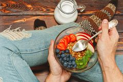 Person habing breakfast on the wooden floor royalty free stock images