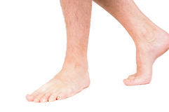 Young male person walking barefooted royalty free stock photography