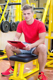 Young male personal trainer holding clipboard Stock Photos