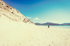 Young male photographer with dreadlocks at a sunny white sand beach with high sand dunes, Luskentyre, Isle of Harris, Hebrides, Sc Stock Photos