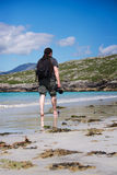 Young male photographer with dreadlocks at a sunny white sand beach. Luskentyre, Isle of Harris, Hebrides, Scotland stock photos