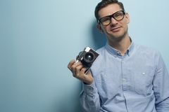 Young male photographer holding a new camera royalty free stock photos