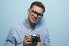 Young male photographer holding a new camera stock images