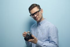 Young male photographer holding a new camera stock photo