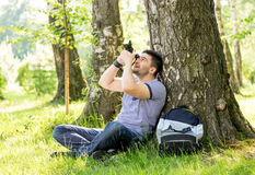 Young male photographer photographing nature on summer day. Royalty Free Stock Image
