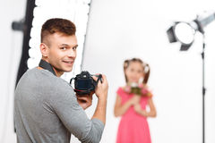 Young male photographer smiles before resuming Stock Images