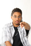 Young Male Pointing. Young African American male pointing, isolated over white background royalty free stock photos