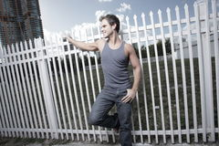 Young male posing by a fence Stock Photography