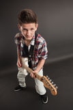 Young male posing with a guitar Royalty Free Stock Image