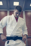 Young male practicing judo in kimono. Royalty Free Stock Image