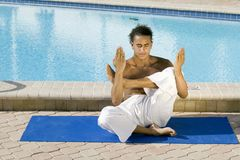 Young male practicing Yoga Stock Photography