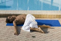 Young male practicing Yoga Royalty Free Stock Photo