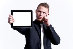 Young male presenting his tablet against Stock Photography