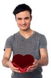 Young male presenting a valentine gift Royalty Free Stock Photos