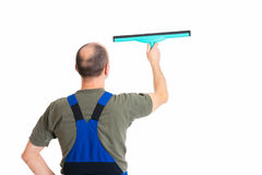 Young male professional cleaner from behind. In front of white background stock photography