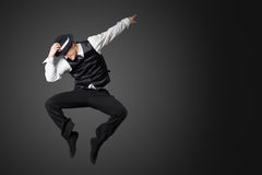 Young male professional dancer dancing in studio. Stock Images