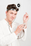 Young male professional doctor with stethoscope. In white uniform Royalty Free Stock Photo