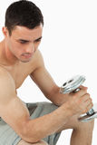 Young male pumping iron Stock Photos