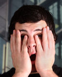Young male reacts to bad news Royalty Free Stock Images