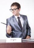 Young male receptionist. Young receptionist showing direction to exit Stock Photos