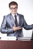 Young male receptionist. Young receptionist showing direction to proceed to check out Royalty Free Stock Photography