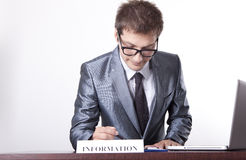 Young male receptionist. Young receptionist at information desk Royalty Free Stock Images