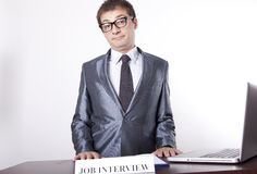 Young male receptionist. Young receptionist showing direction to job interview Royalty Free Stock Images