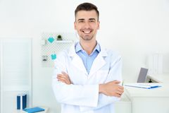 Young male receptionist. Working in hospital stock photography