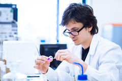 Young male researcher  in a lab Stock Photo