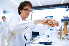 Young male researcher in a lab royalty free stock photo