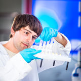 Young male researcher carrying out scientific research in a lab Stock Image